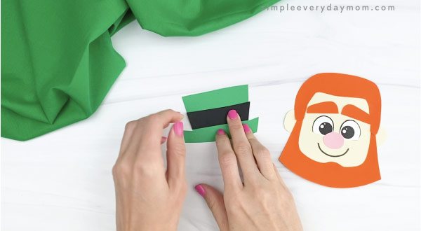 hand glue black band to leprechaun headband hat