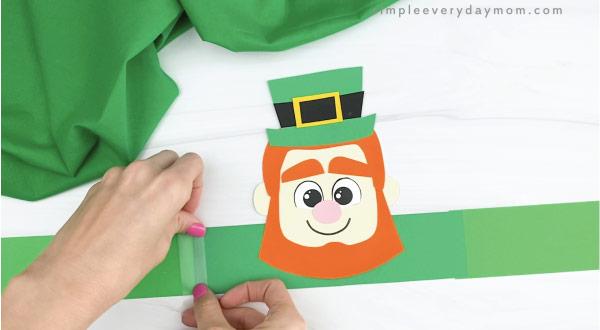 hand taping extender to leprechaun headband craft