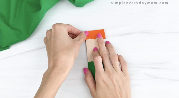 hand gluing hair to popsicle stick leprechaun craft