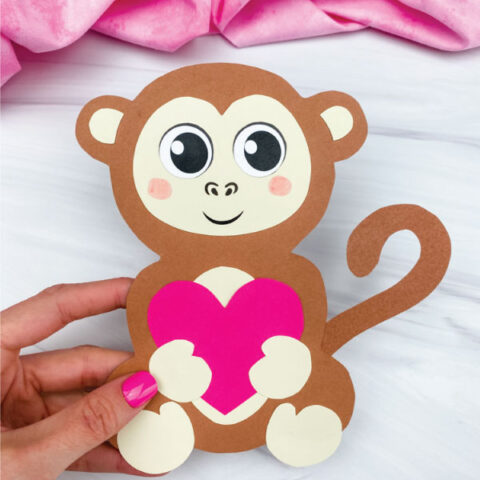 hand holding monkey valentine craft