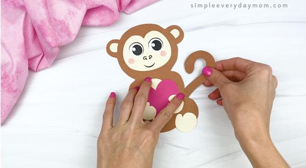 hand gluing tail to monkey valentine craft