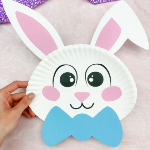 hand holding paper plate Easter bunny