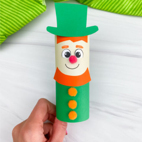 hand holding toilet paper roll leprechaun craft