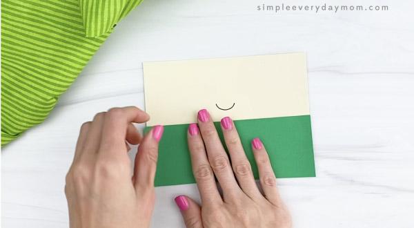 hand gluing shirt to toilet paper roll leprechaun craft
