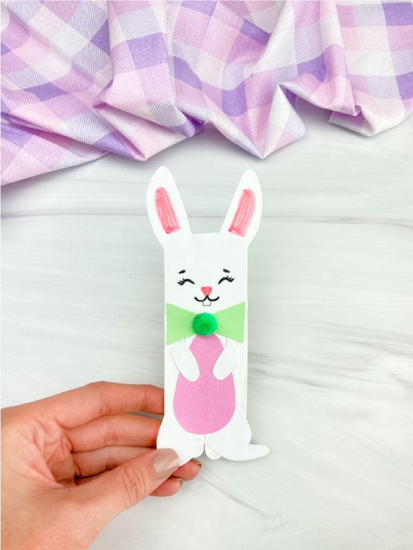 hand holding popsicle stick Easter bunny craft