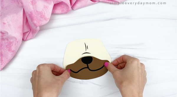 hands gluing mouth onto puppy valentine craft
