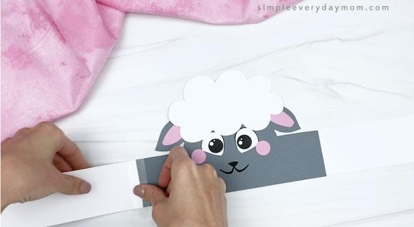 hands taping extender to sheep headband craft