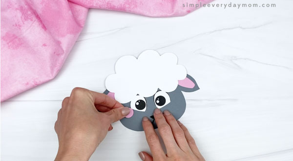 hand gluing cheeks to sheep headband craft