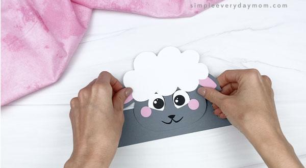 hand gluing head to sheep headband craft