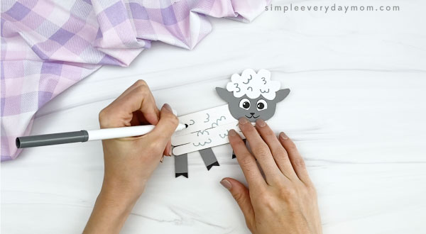 hand drawing on popsicle stick sheep craft