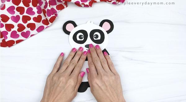 hand gluing head to panda valentine craft