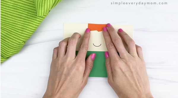 hand gluing hair to toilet paper roll leprechaun craft