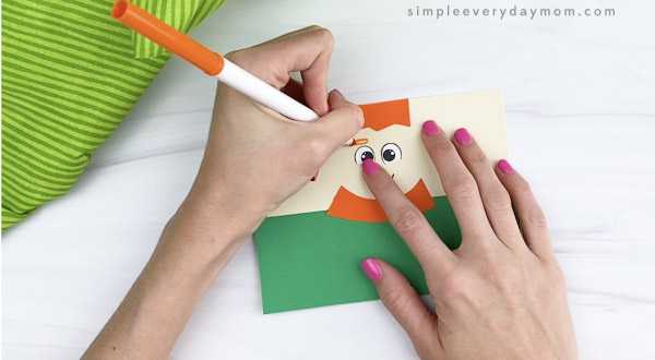 hand drawing eyebrows on toilet paper roll leprechaun craft