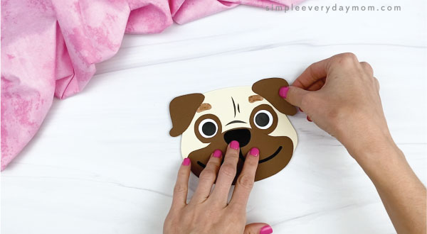hands gluing ears onto puppy valentine craft