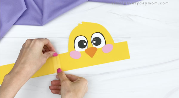 hand taping extender to chick headband craft