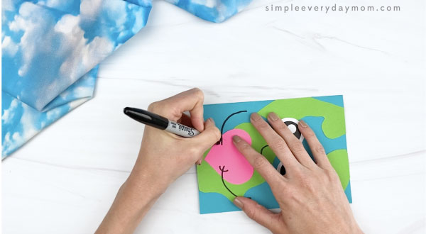 hand drawing arms on Earth card craft