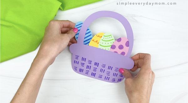 hand glue Easter egg to Easter basket craft