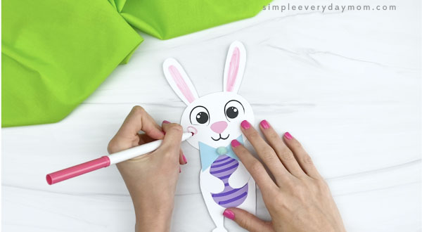 hand coloring cheeks onto paper bunny craft