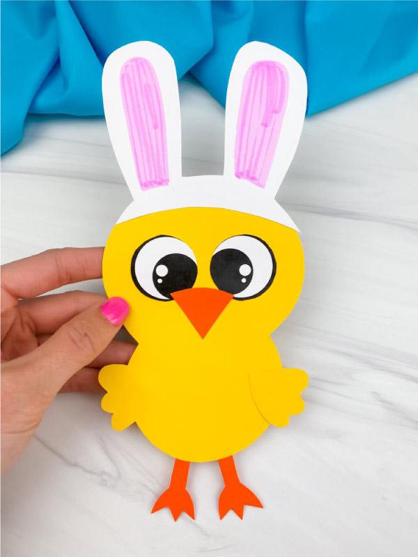 hand holding Easter chick craft