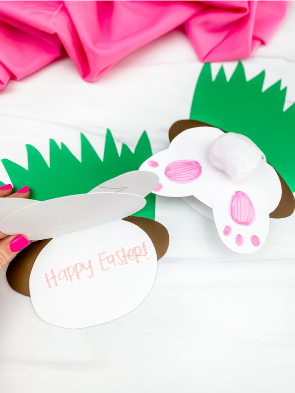 hand opening up Easter bunny butt card