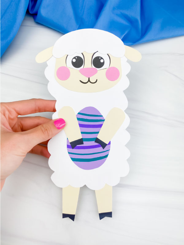 hand holding Easter sheep craft
