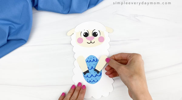 hand gluing arm to Easter sheep craft