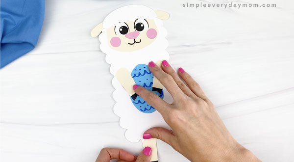 hand gluing leg to Easter sheep craft