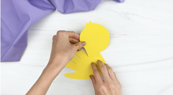 hands gluing head to handprint duck craft