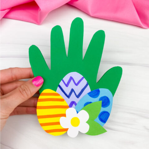 hand holding handprint Easter card craft