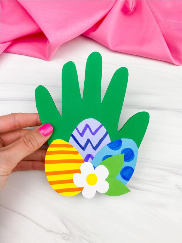 hand holding handprint Easter card craft