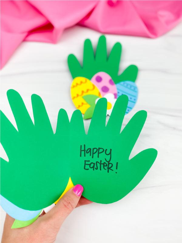 hand holding handprint Easter card craft open