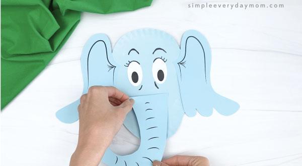 hand gluing trunk onto paper plate horton craft