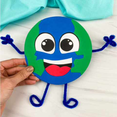 hand holding paper Earth craft