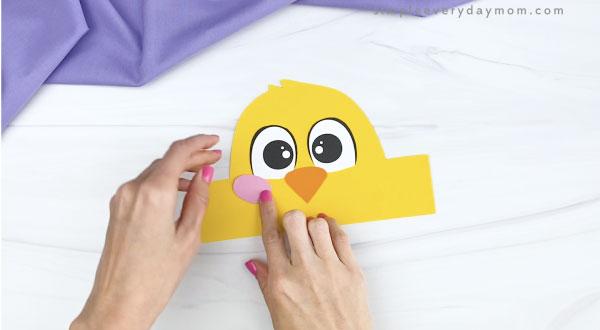 hand gluing cheek to chick headband craft