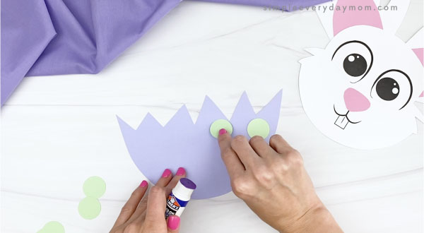 hand gluing circles to paper eggshell