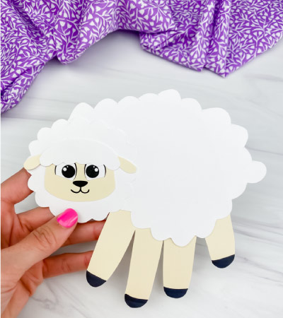 hand holding handprint sheep craft