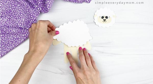 hand gluing body fluff onto handprint sheep craft