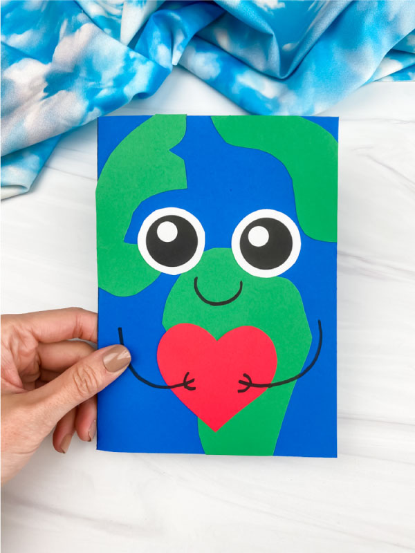 hand holding Earth card craft