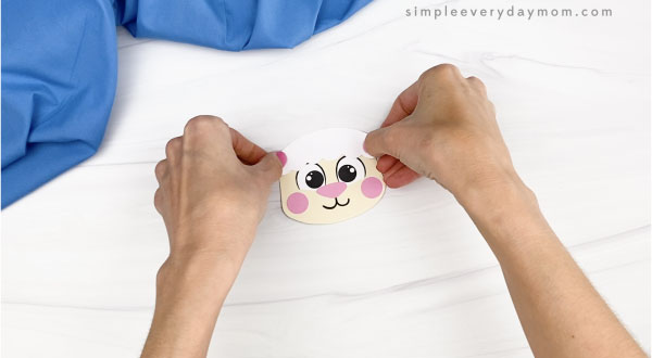 hand gluing bangs to Easter sheep craft