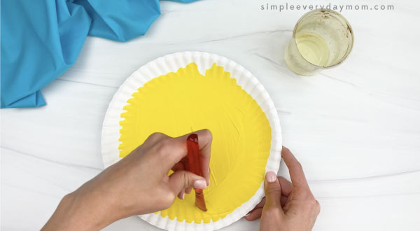 hand painting paper plate yellow