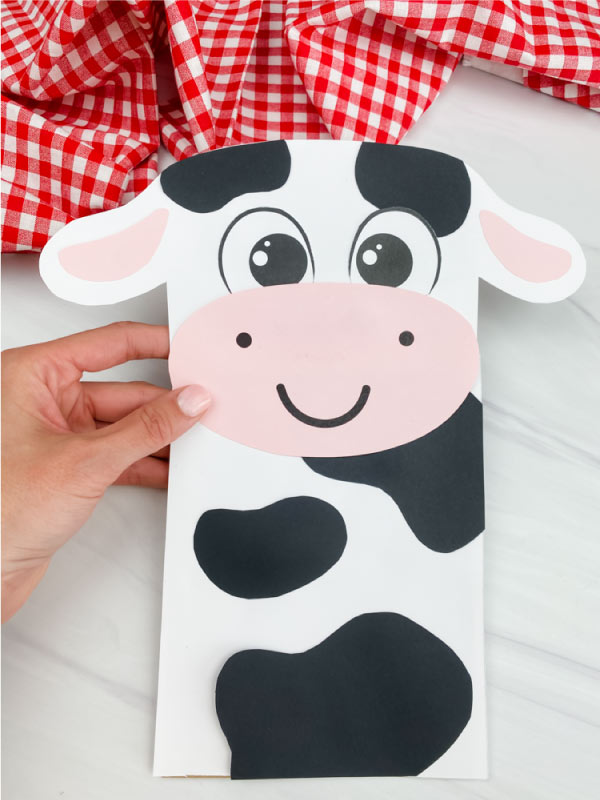 hand holding paper bag cow craft