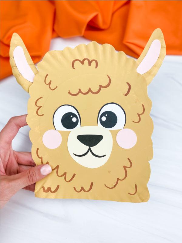 hand holding paper plate llama craft