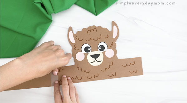 hand taping extender to llama headband craft