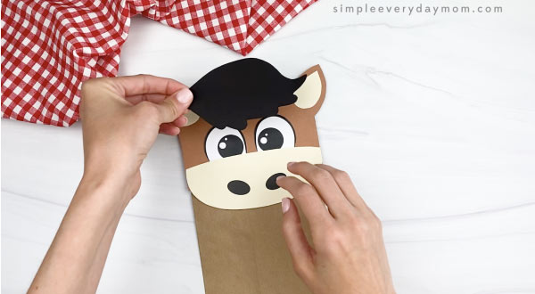 hand gluing hair to paper bag horse craft