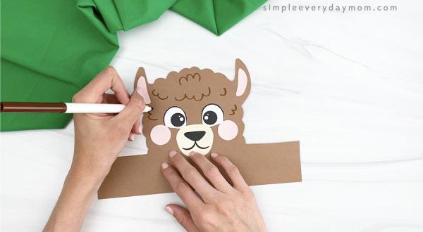 hand drawing fur on llama headband craft