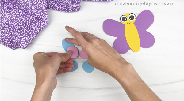 hand gluing wings decorations together