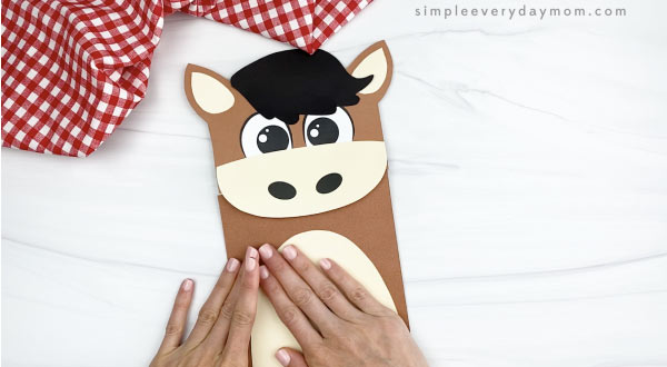 hand gluing belly to paper bag horse craft
