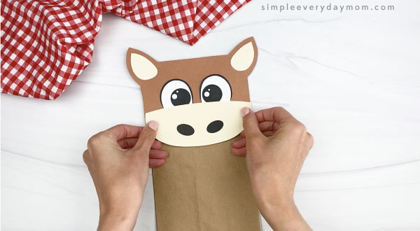 hand gluing nose to paper bag horse craft