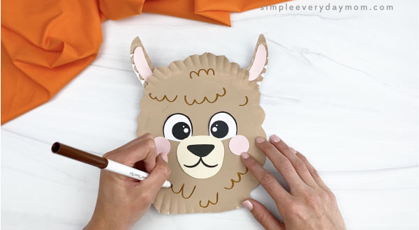 hand drawing fur marks onto paper plate llama craft
