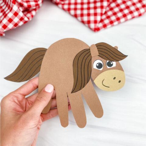 hand holding handprint horse craft